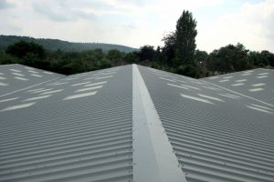 view of new corrugated metal roofs on industrial buildings in Sussex completed by Kingsley Roofing