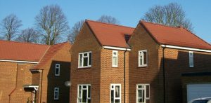 view of several Ministry of Defence residential houses reroofed in smart red tiles by Kingsley Roofing