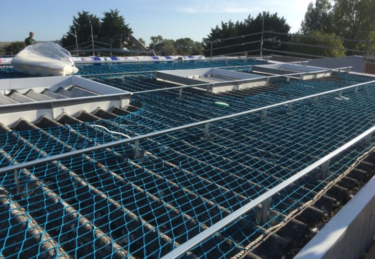 Over roofing with fixings and netting